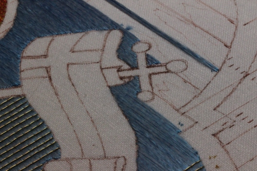Small area left to stitch by upper corner of banner.