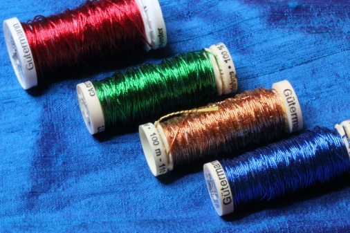 Metallic Passing Threads in Red, Green, Copper and Blue