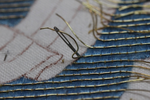 Plunging thread tails of goldwork
