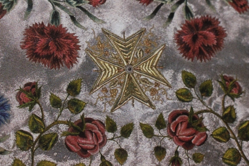 Flowers used to accent a design motif in Ecclesiastical Embroidery