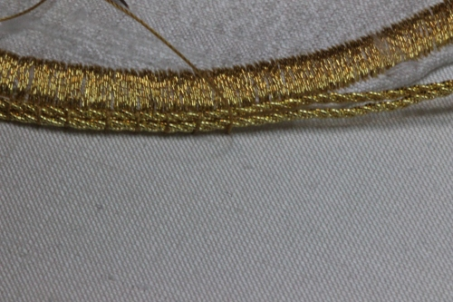 Couching Gold Twist to edge of Ecclesiastical Machine Embroidery Motif using Tyre Silk