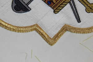 Two rows of Gold Twist #3 couched over edge of Quatrafoil Design