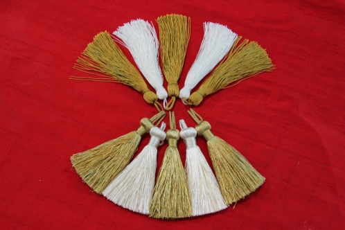 Variations in white and gold tassels for a Pastoral Stole