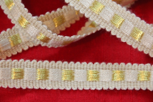 Vestment trim of narrow white Dice Braid